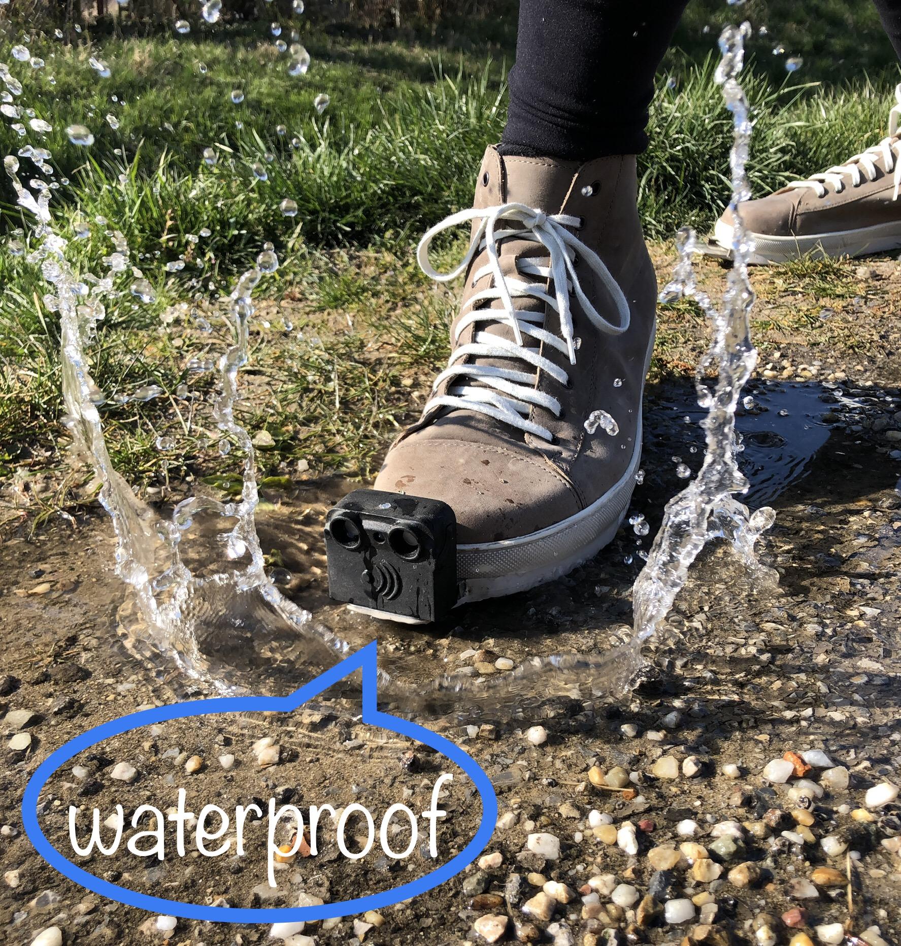 "InnoMake build in a sneaker. Step into the water, water is fishing away. speak bubble: ""waterproof"""