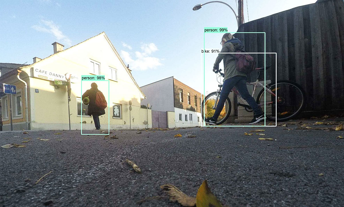 Image: Object detection, girl walk with a bike, frame over girl with text: 99%